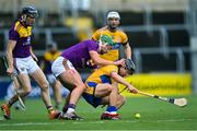 14 November 2020; David Reidy of Clare is tackled by Conor McDonald of Wexford during the GAA Hurling All-Ireland Senior Championship Qualifier Round 2 match between Wexford and Clare at MW Hire O'Moore Park in Portlaoise, Laois. Photo by Piaras Ó Mídheach/Sportsfile