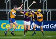 14 November 2020; Jack O'Connor of Wexford is tackled by Tony Kelly, left, and Rory Hayes of Clare during the GAA Hurling All-Ireland Senior Championship Qualifier Round 2 match between Wexford and Clare at MW Hire O'Moore Park in Portlaoise, Laois. Photo by Piaras Ó Mídheach/Sportsfile