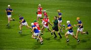 14 November 2020; Mark Coleman of Cork handpasses the ball to team-mate Robbie O'Flynn during the GAA Hurling All-Ireland Senior Championship Qualifier Round 2 match between Cork and Tipperary at LIT Gaelic Grounds in Limerick. Photo by Daire Brennan/Sportsfile