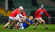 14 November 2020; Séamus Callanan of Tipperary in action against Cork players, Damien Cahalane Bill Cooper and Seán O'Donoghue during the GAA Hurling All-Ireland Senior Championship Qualifier Round 2 match between Cork and Tipperary at LIT Gaelic Grounds in Limerick. Photo by Brendan Moran/Sportsfile