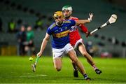 14 November 2020; Ronan Maher of Tipperary in action against Shane Kingston of Cork during the GAA Hurling All-Ireland Senior Championship Qualifier Round 2 match between Cork and Tipperary at LIT Gaelic Grounds in Limerick. Photo by Brendan Moran/Sportsfile