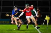 14 November 2020; Dan McCormack of Tipperary in action against Mark Coleman of Cork during the GAA Hurling All-Ireland Senior Championship Qualifier Round 2 match between Cork and Tipperary at LIT Gaelic Grounds in Limerick. Photo by Brendan Moran/Sportsfile