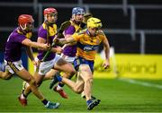 14 November 2020; Rory Hayes of Clare in action against Paul Morris, Lee Chin and Shane Reck of Wexford during the GAA Hurling All-Ireland Senior Championship Qualifier Round 2 match between Wexford and Clare at MW Hire O'Moore Park in Portlaoise, Laois. Photo by Matt Browne/Sportsfile