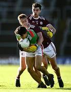 15 November 2020; Tommy Conroy of Mayo in action against Gary O'Donnell, centre, and Sean Mulkerry of Galway during the Connacht GAA Football Senior Championship Final match between Galway and Mayo at Pearse Stadium in Galway. Photo by David Fitzgerald/Sportsfile