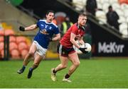 15 November 2020; Liam Kerr of Down in action against Killian Brady of Cavan during the Ulster GAA Football Senior Championship Semi-Final match between Cavan and Down at Athletic Grounds in Armagh. Photo by Philip Fitzpatrick/Sportsfile