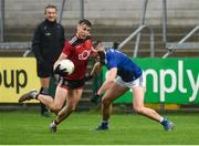 15 November 2020; Barry O'Hagan of Down in action against Killian Clarke of Cavan during the Ulster GAA Football Senior Championship Semi-Final match between Cavan and Down at Athletic Grounds in Armagh. Photo by Philip Fitzpatrick/Sportsfile