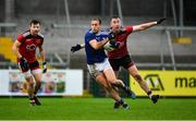 15 November 2020; Pádraig Faulkner of Cavan in action against Paul Devlin of Down during the Ulster GAA Football Senior Championship Semi-Final match between Cavan and Down at Athletic Grounds in Armagh. Photo by Dáire Brennan/Sportsfile