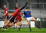 15 November 2020; Oisín Kiernan of Cavan in action against Caolán Mooney of Down during the Ulster GAA Football Senior Championship Semi-Final match between Cavan and Down at Athletic Grounds in Armagh. Photo by Dáire Brennan/Sportsfile