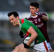 15 November 2020; Diarmuid O'Connor of Mayo in action against Johnny Heaney of Galway during the Connacht GAA Football Senior Championship Final match between Galway and Mayo at Pearse Stadium in Galway. Photo by Ramsey Cardy/Sportsfile