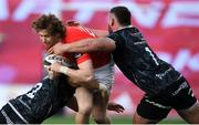 15 November 2020; Ben Healy of Munster is tackled by Ifan Phillips and Gareth Thomas of Ospreys during the Guinness PRO14 match between Munster and Ospreys at Thomond Park in Limerick. Photo by Matt Browne/Sportsfile