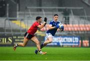 15 November 2020; Ciarán Brady of Cavan in action against Pierce Laverty of Down during the Ulster GAA Football Senior Championship Semi-Final match between Cavan and Down at Athletic Grounds in Armagh. Photo by Dáire Brennan/Sportsfile