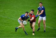 15 November 2020; Oisín Kiernan of Cavan in action against Daniel McGuinness of Down during the Ulster GAA Football Senior Championship Semi-Final match between Cavan and Down at Athletic Grounds in Armagh. Photo by Dáire Brennan/Sportsfile