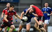 15 November 2020; Pádraig Faulkner of Cavan in action against Conor Poland, left, and Ceilium Doherty of Down during the Ulster GAA Football Senior Championship Semi-Final match between Cavan and Down at Athletic Grounds in Armagh. Photo by Dáire Brennan/Sportsfile
