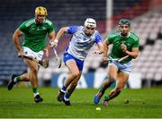 15 November 2020; Dessie Hutchinson of Waterford in action against Dan Morrissey, left, and Sean Finn of Limerick during the Munster GAA Hurling Senior Championship Final match between Limerick and Waterford at Semple Stadium in Thurles, Tipperary. Photo by Ray McManus/Sportsfile