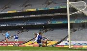 15 November 2020; Seán Bugler of Dublin scores his side's first goal despite the efforts of Trevor Collins, left, and Niall Corbet of Laois during the Leinster GAA Football Senior Championship Semi-Final match between Dublin and Laois at Croke Park in Dublin. Photo by Eóin Noonan/Sportsfile
