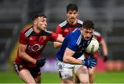 15 November 2020; Ciarán Brady of Cavan in action against Barry O'Hagan of Down during the Ulster GAA Football Senior Championship Semi-Final match between Cavan and Down at Athletic Grounds in Armagh. Photo by Philip Fitzpatrick/Sportsfile