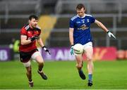 15 November 2020; Jason McLoughlin of Cavan in action against Donal O'Hare of Down  during the Ulster GAA Football Senior Championship Semi-Final match between Cavan and Down at Athletic Grounds in Armagh. Photo by Philip Fitzpatrick/Sportsfile