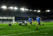 15 November 2020; Dublin players David Byrne, left, and Brian Howard go through a running session, as heat lamps are brought on the pitch, after the Leinster GAA Football Senior Championship Semi-Final match between Dublin and Laois at Croke Park in Dublin. Photo by Piaras Ó Mídheach/Sportsfile