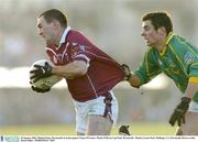 25 January 2004; Michael Ennis, Westmeath, in action against Tomas O'Connor, Meath. O'Byrne Cup Final, Westmeath v Meath, Cusack Park, Mullingar, Co. Westmeath. Picture credit; David Maher / SPORTSFILE *EDI*