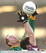 25 January 2004; Donal Curtis, Meath, in action against Joe Fallon, Westmeath. O'Byrne Cup Final, Westmeath v Meath, Cusack Park, Mullingar, Co. Westmeath. Picture credit; David Maher / SPORTSFILE *EDI*