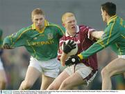 25 January 2004; Donal O'Donoghue, Westmeath, in action against Ray Magee and Adrian Kenny, Meath. O'Byrne Cup Final, Westmeath v Meath, Cusack Park, Mullingar, Co. Westmeath. Picture credit; David Maher / SPORTSFILE *EDI*