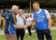 6 July 2013; Clare manager Mick O'Dwyer, left, and Laois manager Justin McNulty exchange a handshake after the game. GAA Football All-Ireland Senior Championship, Round 2, Clare v Laois, Cusack Park, Ennis, Co. Clare. Picture credit: Diarmuid Greene / SPORTSFILE
