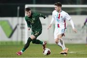 18 November 2020; Timothe Rupil of Luxembourg in action against Danny Grant of Republic of Ireland during the UEFA European U21 Championship Qualifier match between Luxembourg and Republic of Ireland at Stade Henri-Dunant in Beggen, Luxembourg. Photo by Gerry Schmidt/Sportsfile