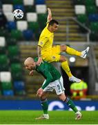 18 November 2020; Liam Boyce of Northern Ireland in action against Dan Nistor of Romania during the UEFA Nations League B match between Northern Ireland and Romania at the National Football Stadium at Windsor Park in Belfast. Photo by David Fitzgerald/Sportsfile