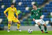 18 November 2020; Michael Smith of Northern Ireland in action against Razvan Marin of Romania during the UEFA Nations League B match between Northern Ireland and Romania at the National Football Stadium at Windsor Park in Belfast. Photo by David Fitzgerald/Sportsfile