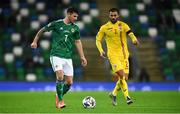 18 November 2020; Matthew Kennedy of Northern Ireland in action against Valentin Cretu of Romania during the UEFA Nations League B match between Northern Ireland and Romania at the National Football Stadium at Windsor Park in Belfast. Photo by David Fitzgerald/Sportsfile