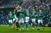 18 November 2020; Liam Boyce of Northern Ireland is congratulated by team-mates after scoring his side's first goal during the UEFA Nations League B match between Northern Ireland and Romania in the National Football Stadium at Windsor Park in Belfast. Photo by David Fitzgerald/Sportsfile