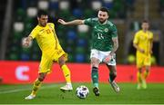 18 November 2020; Camora of Romania in action against Stuart Dallas of Northern Ireland during the UEFA Nations League B match between Northern Ireland and Romania at the National Football Stadium at Windsor Park in Belfast. Photo by David Fitzgerald/Sportsfile