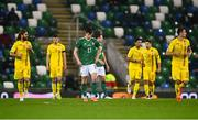 18 November 2020; Paddy McNair of Northern Ireland, centre, reacts as Romania players run back to the centre circle after their side's first goal during the UEFA Nations League B match between Northern Ireland and Romania in the National Football Stadium at Windsor Park in Belfast. Photo by David Fitzgerald/Sportsfile
