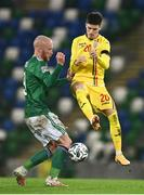 18 November 2020; Liam Boyce of Northern Ireland in action against Dennis Man of Romania during the UEFA Nations League B match between Northern Ireland and Romania in the National Football Stadium at Windsor Park in Belfast. Photo by David Fitzgerald/Sportsfile