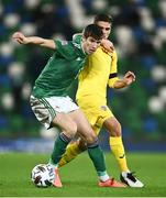 18 November 2020; Paddy McNair of Northern Ireland in action against Razvan Marin of Romania during the UEFA Nations League B match between Northern Ireland and Romania in the National Football Stadium at Windsor Park in Belfast. Photo by David Fitzgerald/Sportsfile