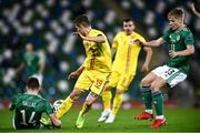 18 November 2020; Florin Tanase of Romania in action against Alistair McCann of Northern Ireland, right, and Stuart Dallas during the UEFA Nations League B match between Northern Ireland and Romania in the National Football Stadium at Windsor Park in Belfast. Photo by David Fitzgerald/Sportsfile