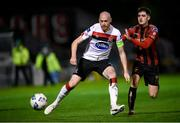 20 November 2020; Chris Shields of Dundalk in action against Dawson Devoy of Bohemians during the Extra.ie FAI Cup Quarter-Final match between Bohemians and Dundalk at Dalymount Park in Dublin. Photo by Stephen McCarthy/Sportsfile