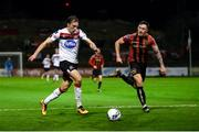 20 November 2020; David McMillan of Dundalk in action against Rob Cornwall of Bohemians during the Extra.ie FAI Cup Quarter-Final match between Bohemians and Dundalk at Dalymount Park in Dublin. Photo by Stephen McCarthy/Sportsfile