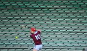 21 November 2020; A general view of empty seats in the stand as Joe Canning of Galway takes a free during the GAA Hurling All-Ireland Senior Championship Quarter-Final match between Galway and Tipperary at LIT Gaelic Grounds in Limerick. Photo by Piaras Ó Mídheach/Sportsfile