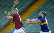 21 November 2020; Brian Concannon of Galway in action against Cathal Barrett of Tipperary during the GAA Hurling All-Ireland Senior Championship Quarter-Final match between Galway and Tipperary at LIT Gaelic Grounds in Limerick. Photo by Piaras Ó Mídheach/Sportsfile