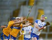 21 November 2020; Stephen Bennett of Waterford in action against David McInerney, left, and Aidan McCarthy of Clare during the GAA Hurling All-Ireland Senior Championship Quarter-Final match between Clare and Waterford at Pairc Uí Chaoimh in Cork. Photo by Harry Murphy/Sportsfile