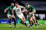 21 November 2020; Chris Farrell of Ireland is tackled by Ollie Lawrence of England during the Autumn Nations Cup match between England and Ireland at Twickenham Stadium in London, England. Photo by Matt Impey/Sportsfile