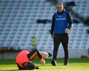 21 November 2020; Clare manager Brian Lohan looks at Tony Kelly of Clare as he goes down in the warm-up prior to  the GAA Hurling All-Ireland Senior Championship Quarter-Final match between Clare and Waterford at Pairc Uí Chaoimh in Cork. Photo by Harry Murphy/Sportsfile