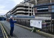 21 November 2020; Dublin supporter Paul Nolan, from Clondalkin, Co Dublin, takes a photo of a memorial on Jones' Road, ahead of the GAA Bloody Sunday Commemoration at Croke Park in Dublin. On this day 100 years ago, Sunday 21 November 1920, an attack by Crown Forces on the attendees at a challenge Gaelic Football match between Dublin and Tipperary during the Irish War of Independence resulted in 14 people being murdered. Along with the 13 supporters that lost their lives that day a Tipperary footballer, Michael Hogan, also died. The main stand in Croke Park, the Hogan Stand, was subsequently named after him. Photo by Dáire Brennan/Sportsfile Photo by Daire Brennan/Sportsfile