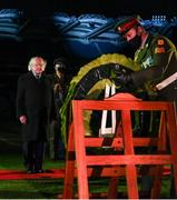 21 November 2020; Aide-De-Camp Sgt Stephen Grennan places a wreath as President Michael D Higgins looks on during the GAA Bloody Sunday Commemoration at Croke Park in Dublin. On this day 100 years ago, Sunday 21 November 1920, an attack by Crown Forces on the attendees at a challenge Gaelic Football match between Dublin and Tipperary during the Irish War of Independence resulted in 14 people being murdered. Along with the 13 supporters that lost their lives that day a Tipperary footballer, Michael Hogan, also died. The main stand in Croke Park, the Hogan Stand, was subsequently named after him. Photo by Stephen McCarthy/Sportsfile