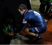 21 November 2020; The Dublin captain Stephen Cluxton places a wreath on behalf of the Dublin team after the Leinster GAA Football Senior Championship Final match between Dublin and Meath at Croke Park in Dublin. Photo by Ray McManus/Sportsfile