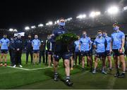 21 November 2020; Dublin captain Stephen Cluxton and team-mates place a wreath following the Leinster GAA Football Senior Championship Final match between Dublin and Meath at Croke Park in Dublin, to commemorate the 100th anniversary of Bloody Sunday. Photo by Stephen McCarthy/Sportsfile