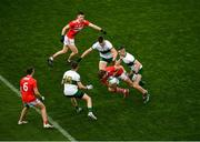 22 November 2020; Ian MaGuire of Cork in action against Tipperary players, left to right, Colman Kennedy, Steven O'Brien, and Michael Quinlivan during the Munster GAA Football Senior Championship Final match between Cork and Tipperary at Páirc Uí Chaoimh in Cork. Photo by Daire Brennan/Sportsfile