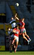 22 November 2020; Steven O'Brien of Tipperary, supported by Liam Casey jumps for the ball against Killian O' Hanlon and Ian MaGuire of Cork during the Munster GAA Football Senior Championship Final match between Cork and Tipperary at Páirc Uí Chaoimh in Cork. Photo by Ray McManus/Sportsfile