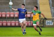 22 November 2020; James Smith of Cavan in action against Paul Brennan of Donegal during the Ulster GAA Football Senior Championship Final match between Cavan and Donegal at Athletic Grounds in Armagh. Photo by Philip Fitzpatrick/Sportsfile